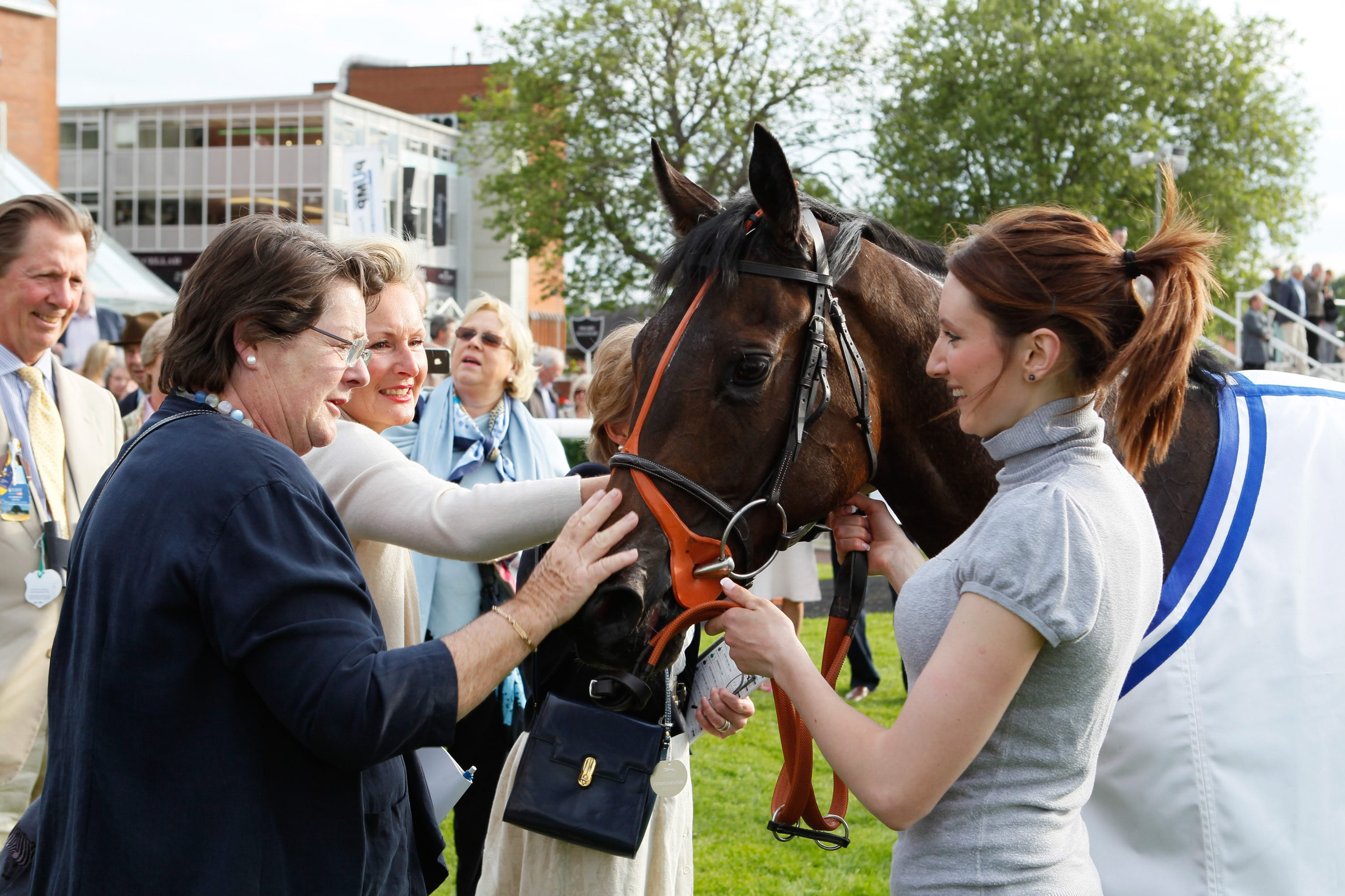 Kendal Mint meeting happy owners after winning at Newbury in 2013