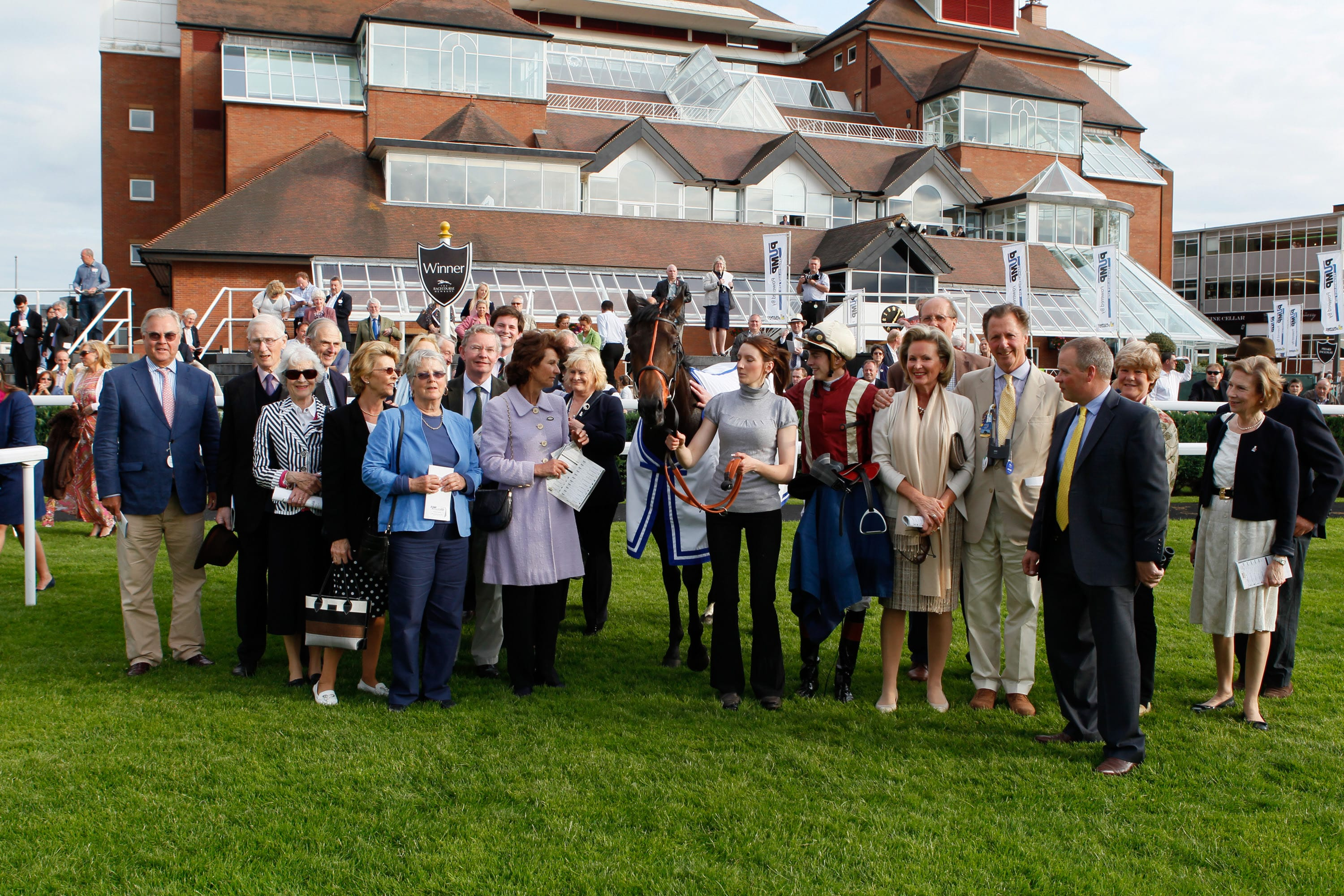 Kendal Mint with happy winning owners at Newbury in 2013