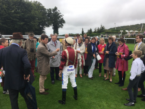 Owners talk with Golden Salute's trainer Andrew Balding